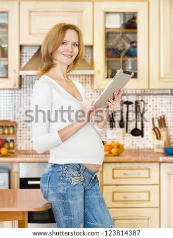 pregnant woman using a digital tablet