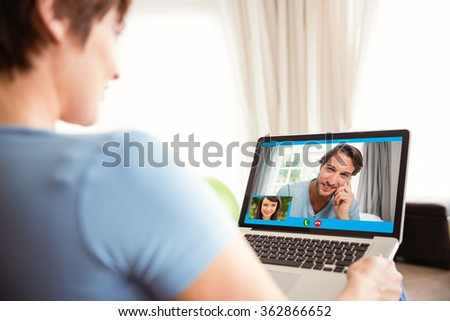 Pregnant woman using her laptop against pretty student smiling at camera outside on campus