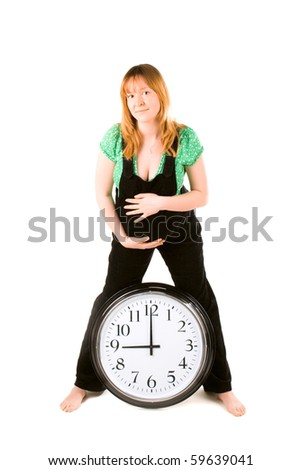 pregnant woman with a clock on white background
