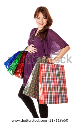 Pregnant woman with bags. Isolated on white