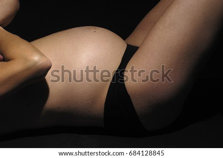pregnant woman with black background #684128845