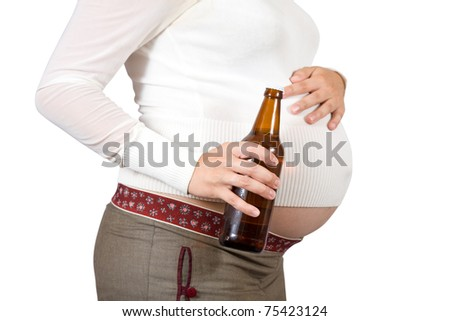 Pregnant woman with  bottle of beer. Isolated over white