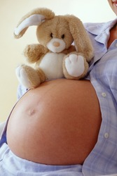 Pregnant woman with stuffed rabbit
