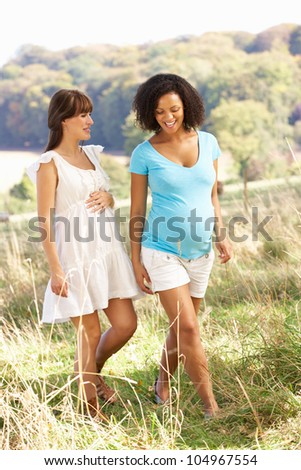 Pregnant women outdoors in countryside