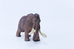 Prehistoric Big tusks Brown Mammoth toy on white background side view