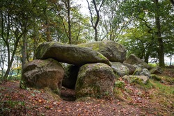 Prehistoric megalithic tomb or dolmen, an excavated and reconstructed passage grave from larges stones in the forest of Klein Gornow, Sternberg, Germany, selected focus, narrow depth of field