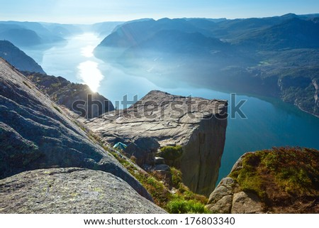 Preikestolen massive cliff (Norway, Lysefjorden summer morning view). Beautiful natural vacation hiking walking travel to nature destinations concept.