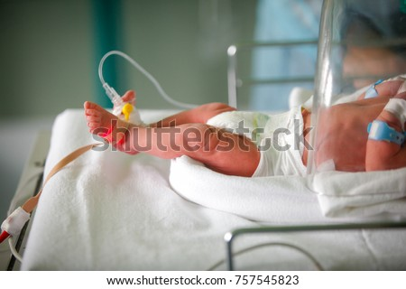 Premature little baby in an incubator at the neonatal section of the maternity - Shutterstock ID 757545823