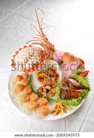 Premium lobster salad cold platter with roasted duck, seafood scallop dishes in white background appetiser halal menu Stock photo ©