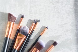 premium makeup brushes on a marble background, creative cosmetics flat lay, tools for make up, copy space