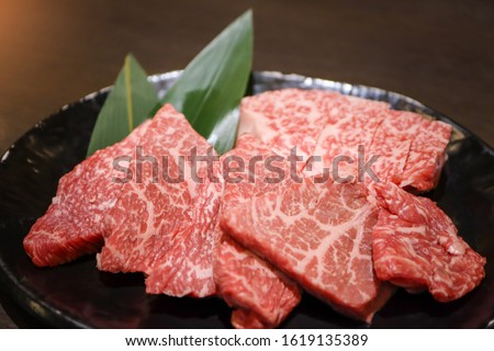 Premium quality raw sliced wagyu beef A5 steak in the black plate for yakiniku. Japanese foods style.