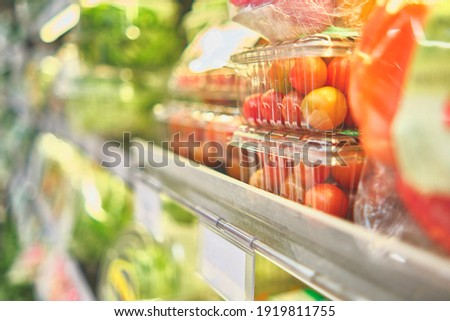 Prepackaged salads in a commercial refrigerator, salad ready to eat. Concept of healthy food, bio, vegetarian, diet. Selective focus.