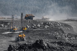 Preparation boring machines of site for blasting, mineral exploration. Open pit mine industry.