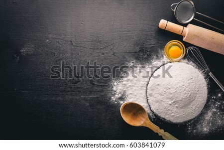 Preparation for baking. Eggs with a rolling pin. On the stone table. Free space for text . Top view.
