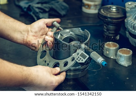Preparation for renovation, professional repair of a diesel engine. The mechanic checks the condition of individual components, i.e. injectors, pistons, shaft, cylinders, body. Professional service.