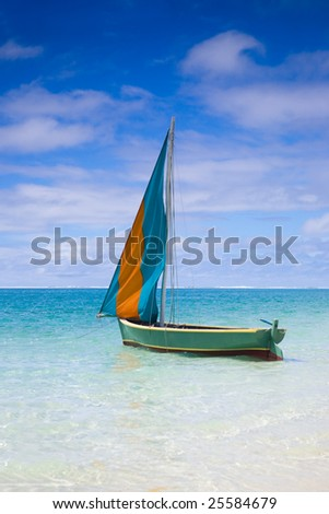 "Preparation for start of a sailing regatta in Mauritius. Colorful traditional Mauritian wooden boat called ""Pirogue""."