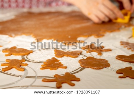 preparation of desserts. Women's hands cut out shapes for cookies stock photo