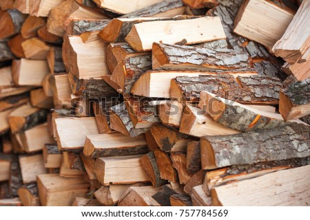 Preparation of firewood for the winter. firewood background, Stacks of firewood in the forest. Pile of firewood. #757784569