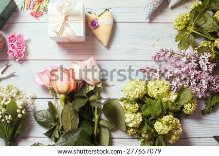 Preparation of flower bouquet, top view of florist workplace with copy space