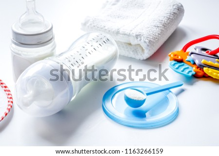 preparation of mixture baby feeding on white background