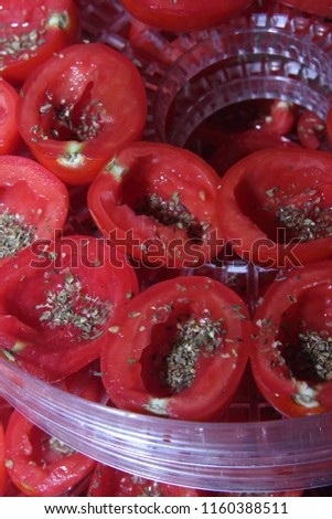 preparation of raw materials for drying, preparation of dried tomatoes with aromatic Italian herbs  #1160388511