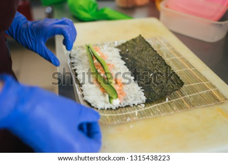 Preparation of rolls. Rolls to go. Colorful rolls in lunch box. Japanese cuisine. Chinese cuisine. Sushi for lunch.