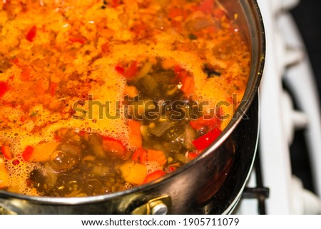 Preparation of soup with chicken and vegetables. Close up of boiling soup. Foto stock ©