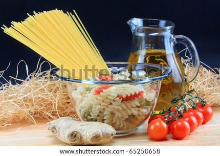 Preparation of spaghetti pasta with tomatoes, ginger and olive oil