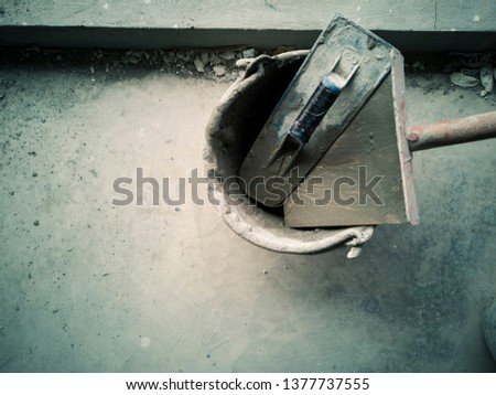 Preparation of tools and mortar plastered the walls in a building under construction #1377737555
