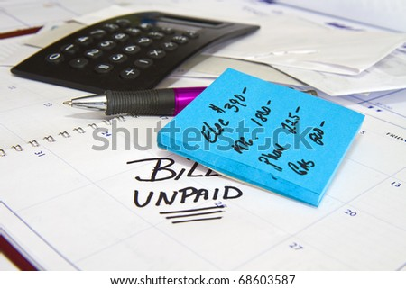 Preparation to pay monthly bills including calulator,pen and notes on calander