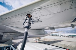 Preparations before flight. Refueling of airplane at airport. Travel and industry concepts.