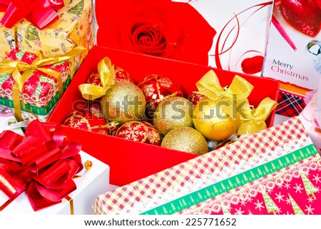 Preparations for the Christmas holiday. Gifts in festive packaging, decoration for Christmas tree, shiny balls with bows