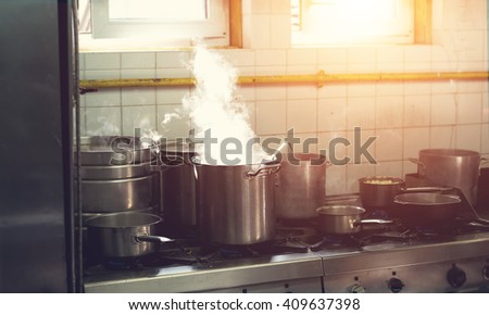 Prepare a lot of food. In a saucepan, boil the water. Cook. Restaurant kitchen. The restaurant\'s cuisine. Hot time. Industrial kitchen. Cooking food - process.