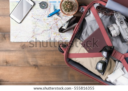 prepare accessories and travel items on white wooden board, flat lay, top view background