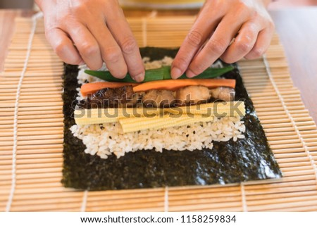 prepare and make homemade sushi on the table at home #1158259834