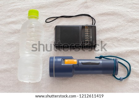 Prepare for disasters Water, radio, flashlight #1212611419