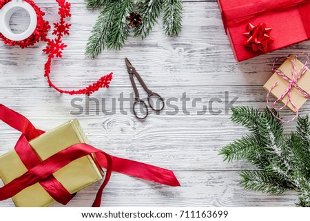 prepare new year and christmas 2018 presents in boxes on light wooden background top veiw #711163699
