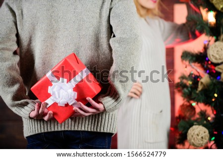 Prepare surprise. Winter surprise. Man carry gift box behind back defocused background. Christmas surprise concept. Surprising his wife. Giving and sharing. Surprise effect. Generosity and kindness.