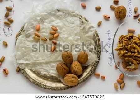 Prepare Traditional Turkish Ramadan Dessert Gullac with;Gullac sheets,rose water,walnuts,hazelnuts,pistachio,milk,pomegranate seeds and sugar.Oldest and very light dessert.