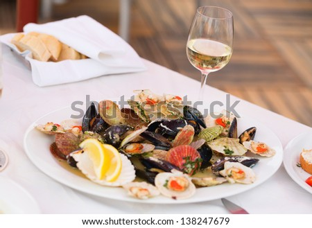 Prepared clams and glass of white wine