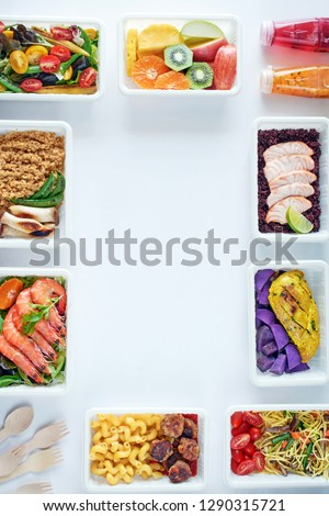 Prepared food delivery concept. Top view of assorted ready to eat meals over white background with copy space.