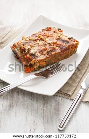 Prepared lasagne with veggies in a dish