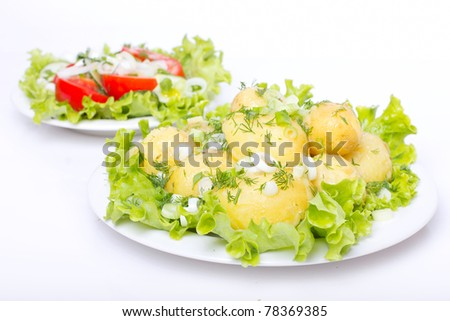 Prepared potatoes with salad