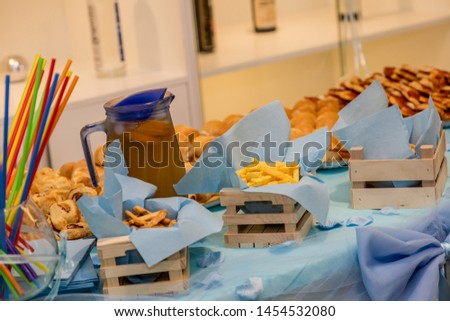 Prepared Table for party with salty crackers, tortilla chips and other savory snacks, unhealthy snacks