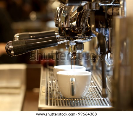 prepares espresso in his coffee shop; close-up