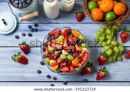 Preparing a healthy spring fruit salad