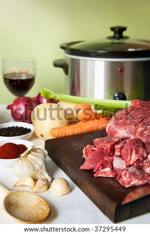 Preparing a slow-cooker beef casserole.  Simple, homely food.
