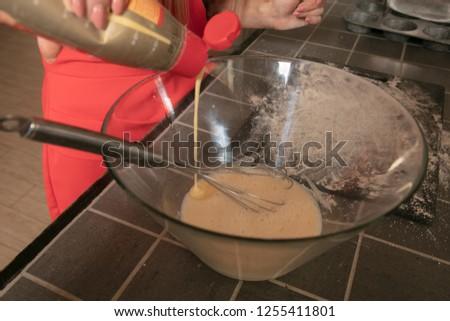 preparing cakes for baking