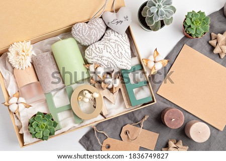 Preparing care package, seasonal gift box with candles, succulent, interior scent. Personalized eco friendly basket for family and friends for thankgiving, christmas, mothers day holidays.  Photo stock ©