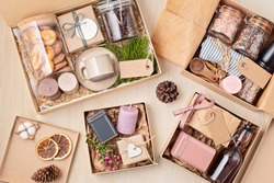 Preparing care package, seasonal gift box with coffee, cookies, spices and cups. Personalized eco friendly basket for family and friends for thankgiving, christmas, mothers and fathers day holidays